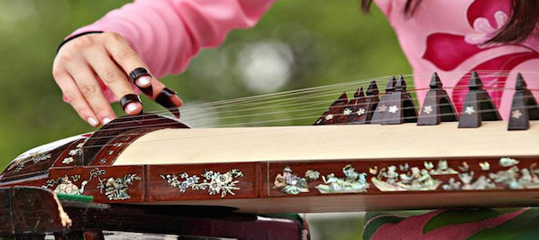 This Zither musical instrument is played on the embassy open house day in Washington D.C, close to the Dupont Circle hotel.