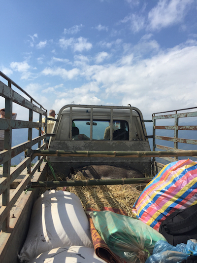 Travelling in the back of a farm truck in Laos, by Pierce Lowney of The River Lee in Cork