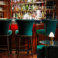 Bloomsbury Club in The Bloomsbury hotel - gorgeous green bar chairs and bar shot