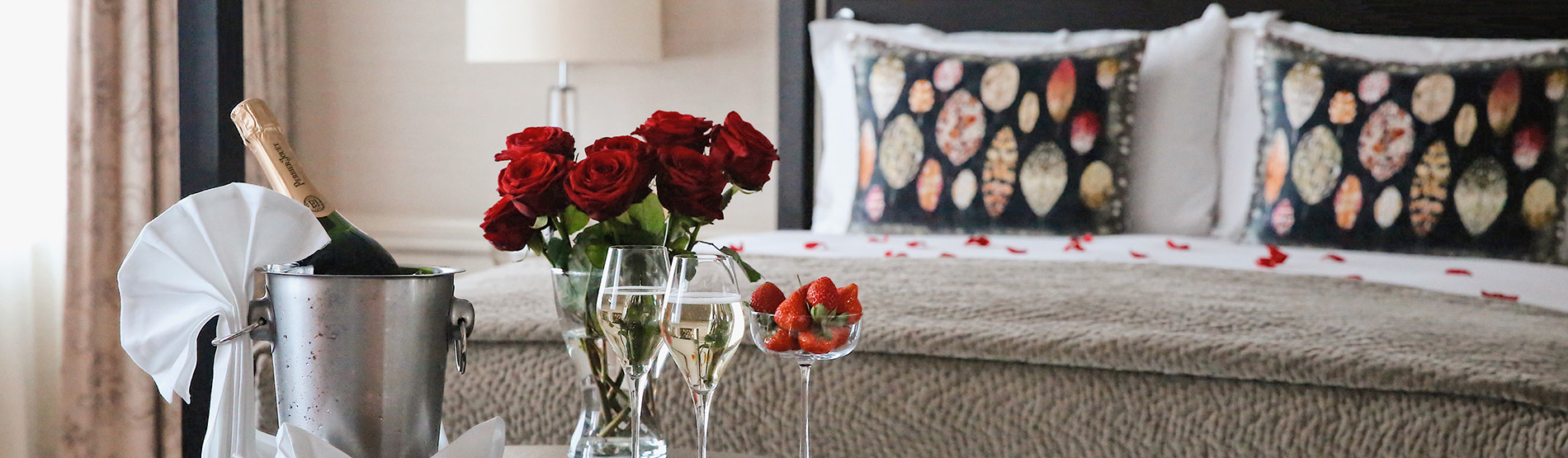 Bedroom with Champagne and red roses