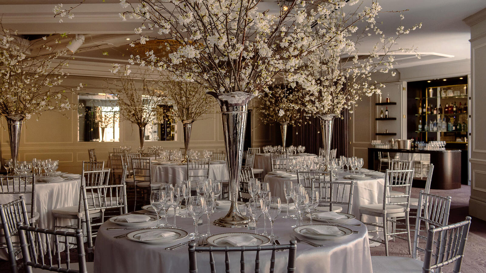 Tables laid for Wedding breakfast with Spring flower center pieces