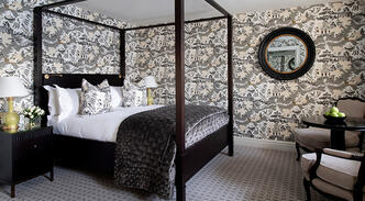 Room with four poster bed