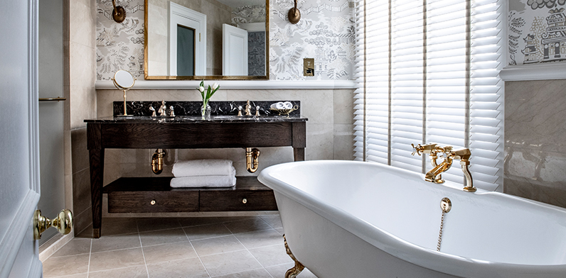 Bathroom with bath and sink