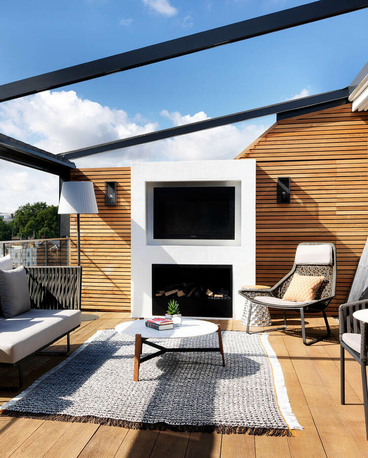 The stylish and luxurious surrounds of The Terrace Suites outdoor area with stunning views of London