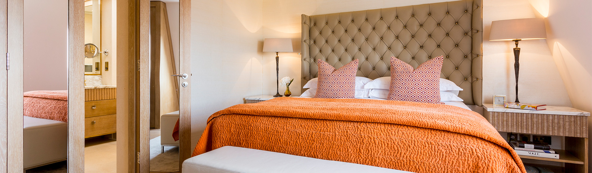 The Harley Suite, spacious suite with orange hues bringing a wlecoming warmth to the suite