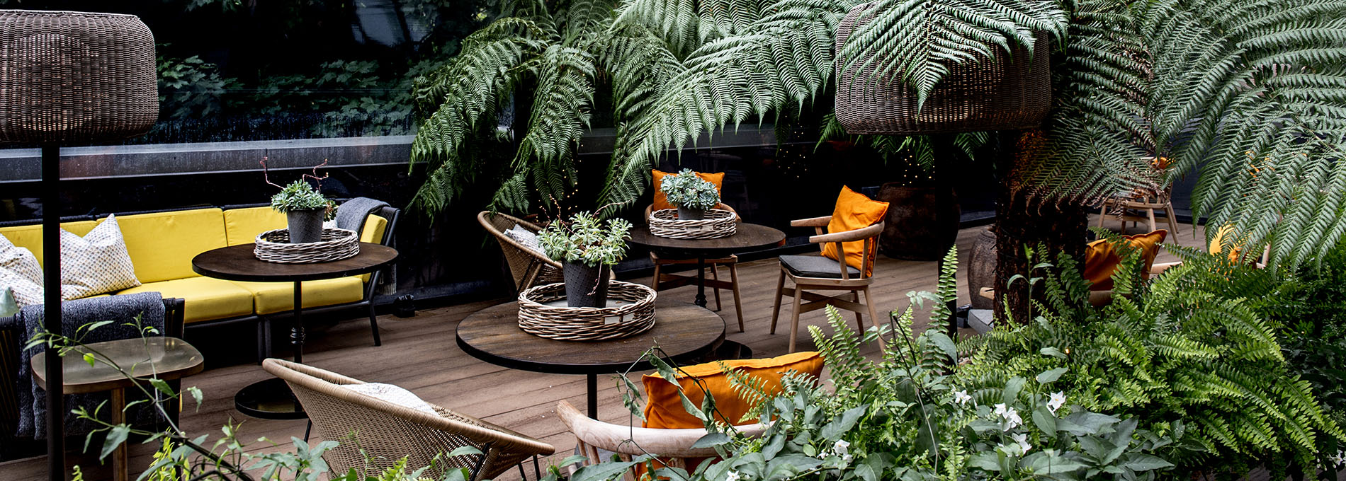 Outdoor terrace with seating and greenery