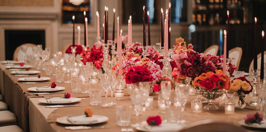 Dinner table decorated with candles and flowers
