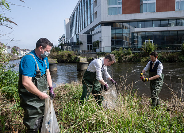 Staff from The River Lee planting willow trees along the river