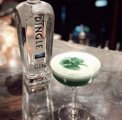 St. Patrick's Day cocktail with a bottle of Dingle Gin